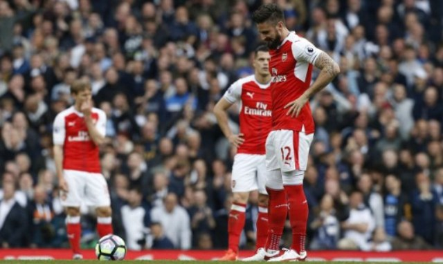Arsenal's French striker Olivier Giroud (R) reacts to the penalty scored by Tottenham Hotspur's English striker Harry Kane during the English Premier League football match between Tottenham Hotspur and Arsenal at White Hart Lane in London, on April 30, 2017.  / AFP PHOTO / IKIMAGES / Ian KINGTON / RESTRICTED TO EDITORIAL USE. No use with unauthorized audio, video, data, fixture lists, club/league logos or 'live' services. Online in-match use limited to 75 images, no video emulation. No use in betting, games or single club/league/player publications.  /