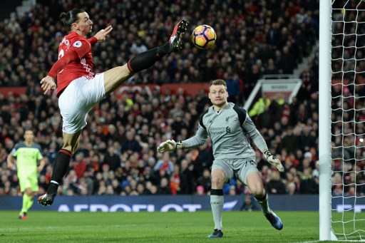 (FILES) This file photo taken on January 15, 2017 shows Manchester United's Swedish striker Zlatan Ibrahimovic (L) jumps for the ball but fails to score during the English Premier League football match between Manchester United and Liverpool at Old Trafford in Manchester, north west England, on January 15, 2017. Zlatan Ibrahimovic has rejoined Manchester United on a one-year contract on August 24, 2017 after the Swedish star's spell with the Premier League side was curtailed by a serious knee injury last season. Ibrahimovic missed the final weeks of United's campaign after suffering ligament damage in a Europa League clash against Anderlecht in April 2017.  / AFP PHOTO / Oli SCARFF / RESTRICTED TO EDITORIAL USE. No use with unauthorized audio, video, data, fixture lists, club/league logos or 'live' services. Online in-match use limited to 75 images, no video emulation. No use in betting, games or single club/league/player publications.  /