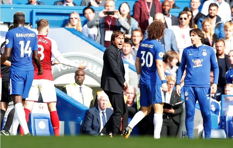"""Soccer Football - Premier League - Chelsea vs Arsenal - Stamford Bridge, London, Britain - September 17, 2017   Chelsea manager Antonio Conte reacts after David Luiz was shown a red card   Action Images via Reuters/John Sibley    EDITORIAL USE ONLY. No use with unauthorized audio, video, data, fixture lists, club/league logos or """"live"""" services. Online in-match use limited to 75 images, no video emulation. No use in betting, games or single club/league/player publications. Please contact your account representative for further details."""