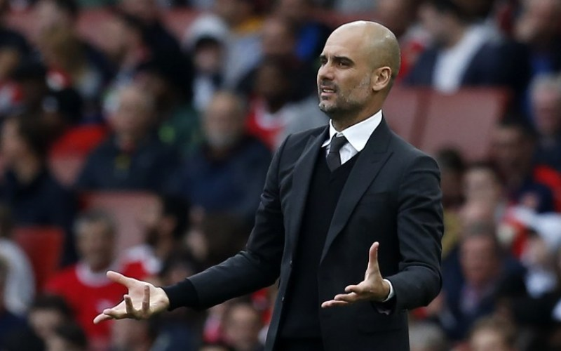 Manchester City's Spanish manager Pep Guardiola gestures on the touchline during the English Premier League football match between Arsenal and Manchester City at The Emirates in London, on April 2, 2017. / AFP PHOTO / IKIMAGES / Ian KINGTON / RESTRICTED TO EDITORIAL USE. No use with unauthorized audio, video, data, fixture lists, club/league logos or 'live' services. Online in-match use limited to 45 images, no video emulation. No use in betting, games or single club/league/player publications.